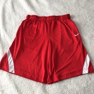 Red and white Nike dri-fit athletic shorts